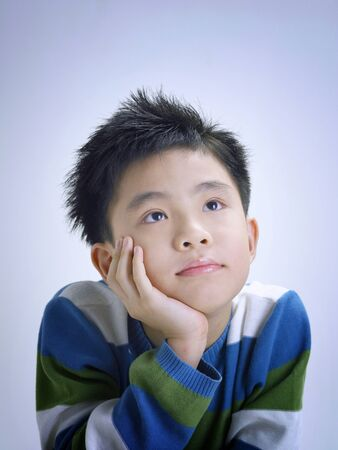 Boy daydreaming