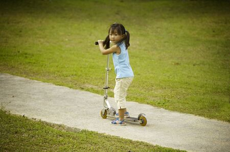 Girl riding on kick scooter