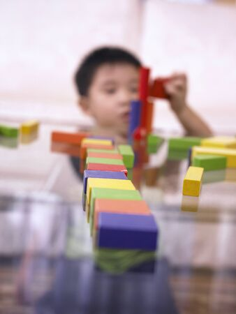 Boy playing with wooden blocks