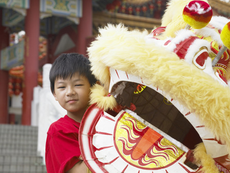 young performer holding lion costume