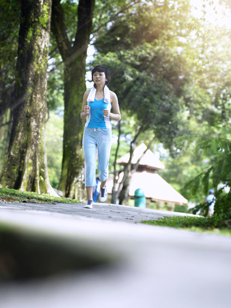 foreground focus on floor with woman jogging behind