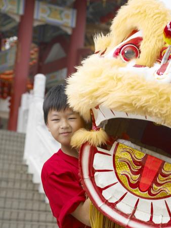 boy lifting lion head
