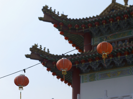 red lanterns hanging out side of the temple