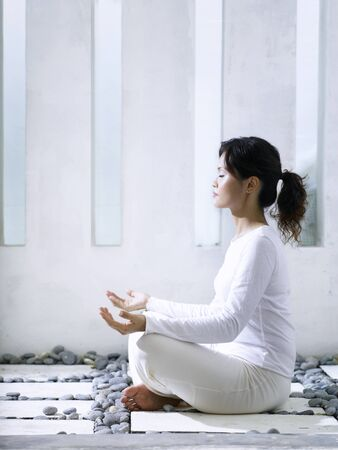 woman meditating in the garden Stock Photo