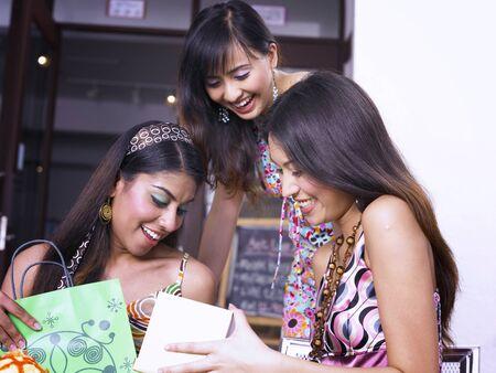 Three women at outdoor garden cafe 写真素材