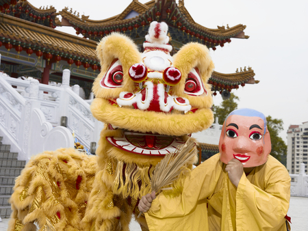 lion dance performers posing to camera