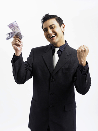 businessman feeling excited with stack of money Stock Photo