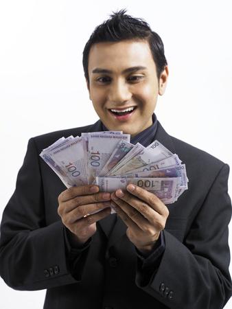 businessman holding money Banque d'images