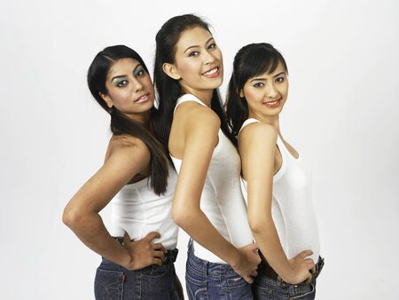 side view of three women