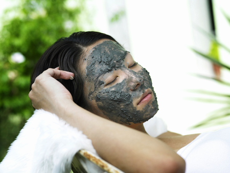 woman having facial treatment outdoor