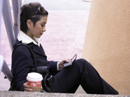 businesswoman texting messages outdoor