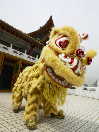 side view of the lion dance performer Stock Photo