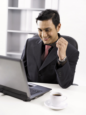 businessman at work place, smiling Stock Photo