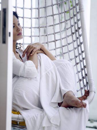 woman sitting in the swing