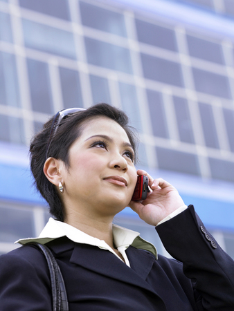 businesswoman on cellphone, outdoor