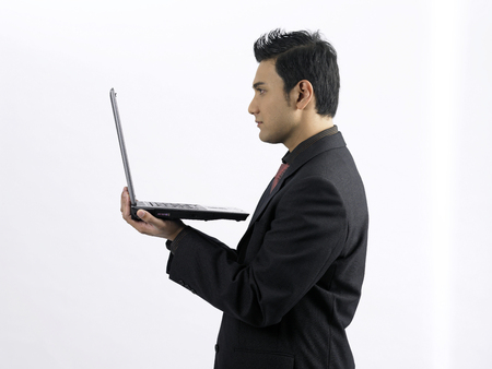 man looking at the laptop