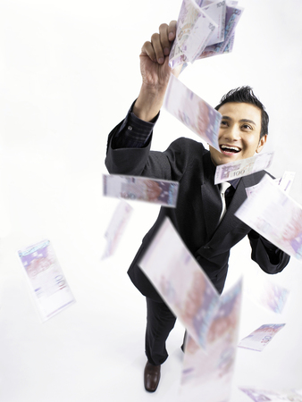 high angle of businessman grabbing money Reklamní fotografie