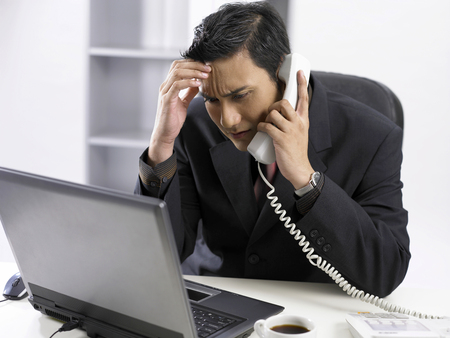 a tired businessman on the phone Stock Photo