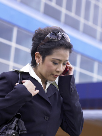 businesswoman on cellphone, outdoor