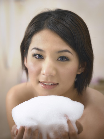 woman in bath room holding suds