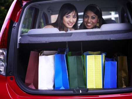 young women in the car, full of shopping bags
