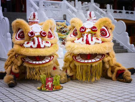 2 lion dance performer sitting side by side Stock Photo