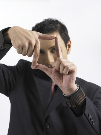 businessman focus with his fingers frame