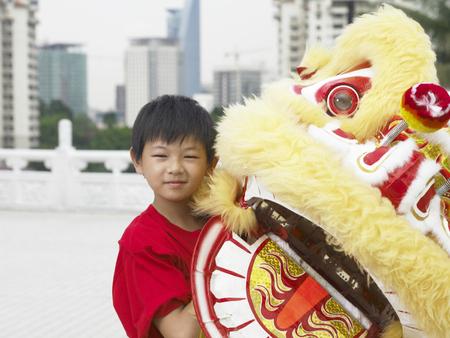boy holding lion costume