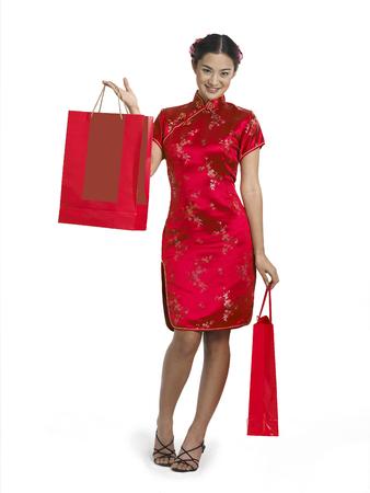 woman in cheongsam holding shopping bags