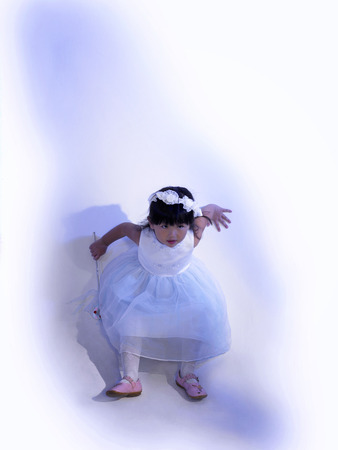 Innocent little girl playing around Stock Photo