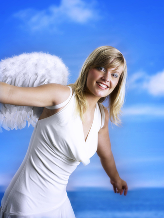 Happy woman with angel wings Imagens