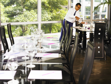 A waiter set up the dining table