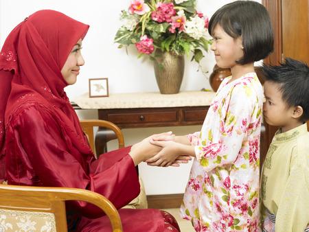 Malay mother celebrate Hari Raya with children 写真素材