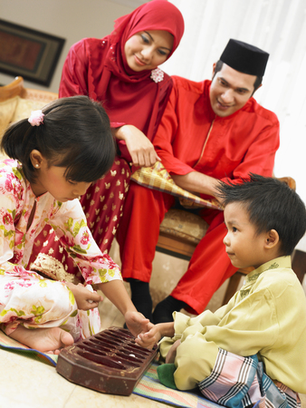 Family of four playing together