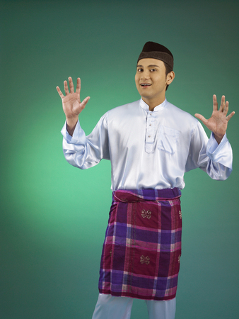 Young malay man smiling and excited
