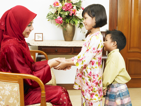 Malay mother celebrate Hari Raya with daughter and son 写真素材