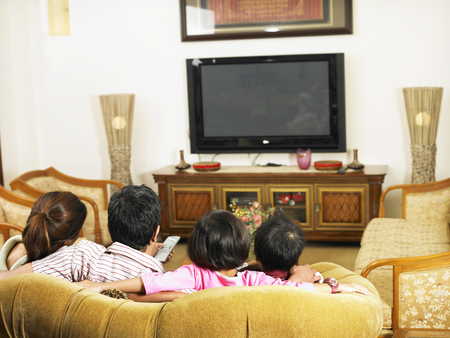 back view of family in the living room