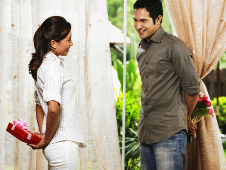 couple exchanging gifts Stock Photo