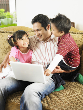 man and children on laptop