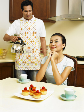 couple making tea in the kitchen Stock Photo