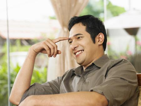 profile of man thinking, smiling Stock Photo