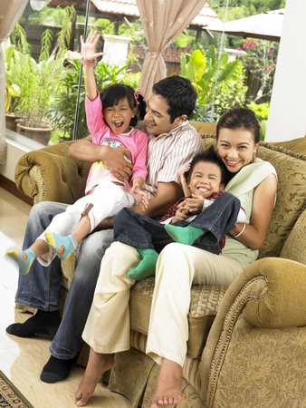 family having fun in the living room Stock Photo