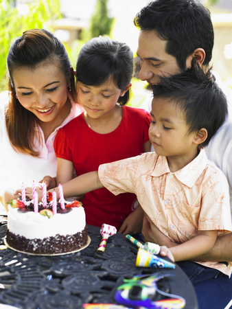 boy celebrating birthday together with his family Stock fotó