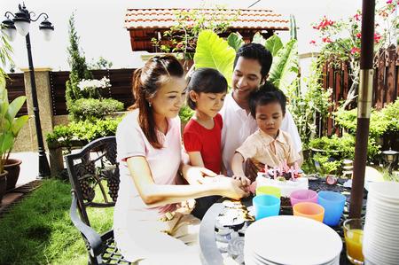 family having birthday party in the garden