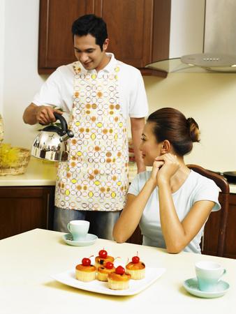 couple having tea break in the kitchen