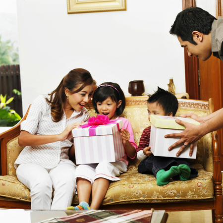 parent sharing presents with their children