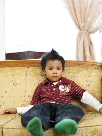 potrait of young boy sitting, alone Stock Photo