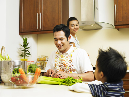 family preparing food in the kitchen Stock Photo