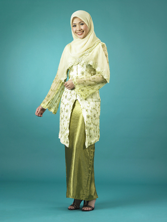 Young lady in baju raya and smiling Stock fotó