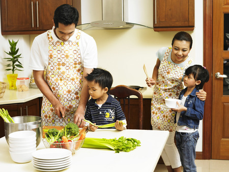 Family cooking in the kitchen together Stockfoto